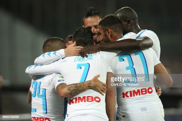 Napoli's Belgian forward Dries Mertens celebrates with teammates after scoring during the Italian Serie A football match SSC Napoli vs Fiorentina ACF...
