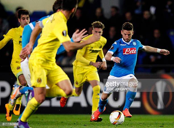 Napoli's Belgian forward Dries Mertens dribbles the ball during the UEFA Europa League Round of 32 first leg football match Villarreal CF vs SSC...