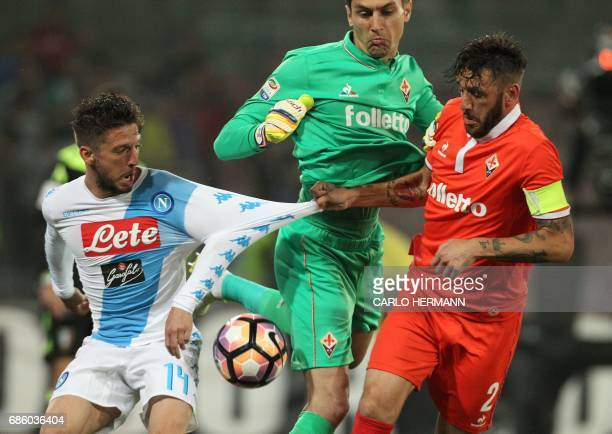 Napoli's Belgian forward Dries Mertens fights for the ball with Fiorentina's goalkeeper from Romania Ciprian Tatarusanu and Fiorentina's defender...