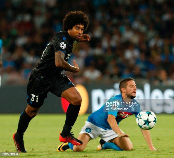 Napoli's Belgian forward Dries Mertens fights for the ball with Nice's Brazilian defender Bonfim Dante during the UEFA Champions League Play Off...