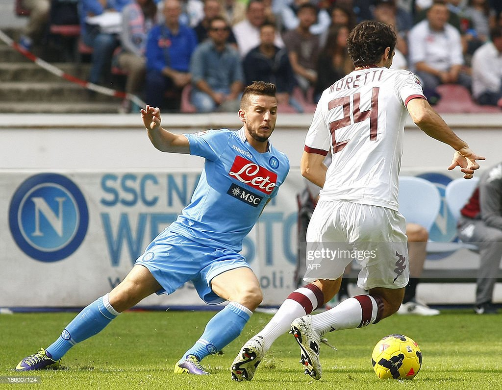 Napoli's Belgian forward Dries Mertens (L) fights for the ball with Torino's defender Emiliano Moretti during the Italian Serie A football match SSC Napoli vs Torino FC in San Paolo Stadium on October 27, 2013. HERMANN