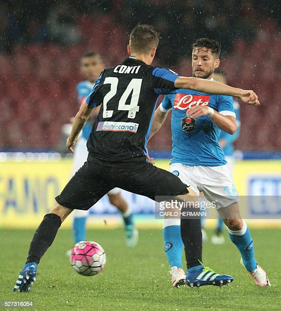 Napoli's Belgian forward Dries Mertens fights for the ball with Atalanta's Italian defender Andrea Conti during the Italian Serie A football match...