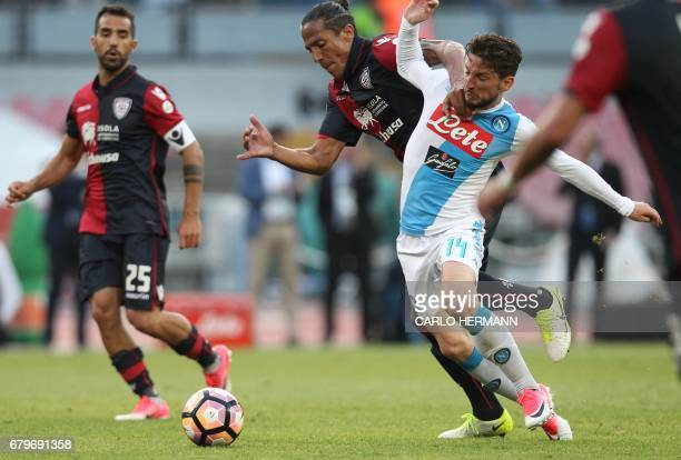 Napoli's Belgian forward Dries Mertens fights for the ball with Cagliari's Portuguese defender Bruno Alves during the Italian Serie A football match...