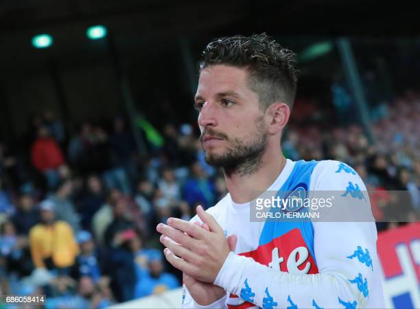 Napoli's Belgian forward Dries Mertens greets the fans at the end of the Italian Serie A football match SSC Napoli vs Fiorentina ACF on May 20 2017...