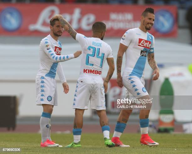 Napoli's Belgian forward Dries Mertens is congratulated by teammates Napoli's Italian forward Lorenzo Insigne and Napoli's Slovakian midfielder Marek...
