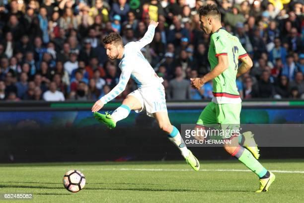 Napoli's Belgian forward Dries Mertens kicks the ball in front of Crotone's Italian defender Gian Marco Ferrari during the Italian Serie A football...