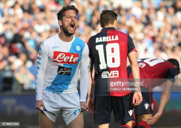 Napoli's Belgian forward Dries Mertens reacts after missing a goal during the Italian Serie A football match SSC Napoli vs Cagliari Calcio on May 6...