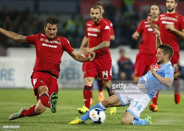 Napoli's Belgian forward Dries Mertens vies with Italian midfielder Daniele Dessena during the Italian Serie A football match SSC Napoli vs Cagliari...