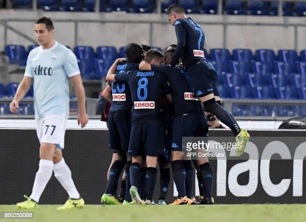 Napoli's Belgian striker Dries Mertens celebrates after scoring a goal during the Italian Serie A football match between Lazio and Napoli at Olympic...