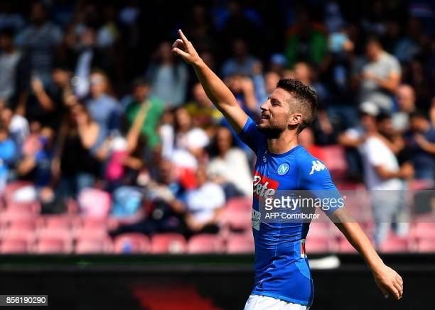 Napoli's Belgian striker Dries Mertens celebrates after scoring a penalty kick during the Italian Serie A football match Napoli vs Cagliari on...