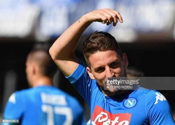 Napoli's Belgian striker Dries Mertens celebrates after scoring during the Italian Serie A football match Napoli vs Benevento on September 17 2017 at...