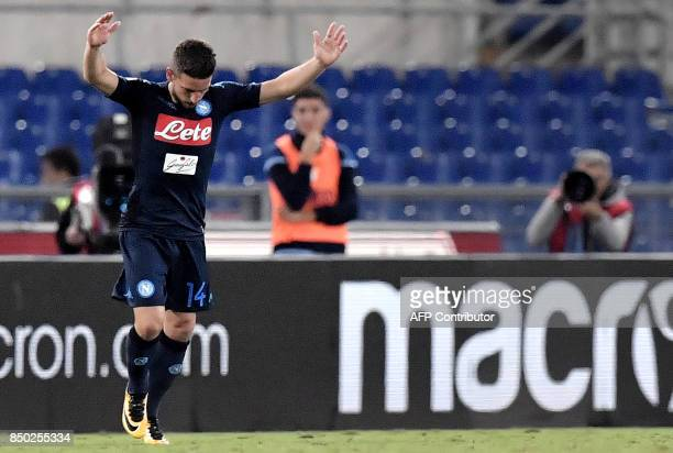 Napoli's Belgian striker Dries Mertens celebrates after scoring during the Serie A football match between Lazio and Napoli at Olympic Stadium in Rome...