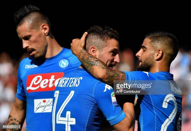 Napoli's Belgian striker Dries Mertens celebrates with Napoli's Italian striker Lorenzo Insigne and Napoli's Slovakian midfielder Marek Hamsik after...