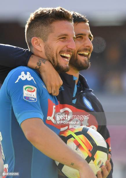 Napoli's Belgian striker Dries Mertens celebrates with Napoli's Italian striker Lorenzo Insigne at the end of the Italian Serie A football match...