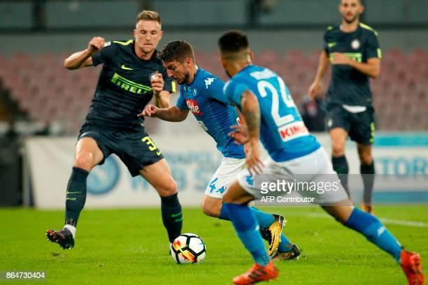 Napoli's Belgian striker Dries Mertens fights for the ball with Inter Milan's Slovak defender Milan Skriniar during the Italian Serie A football...