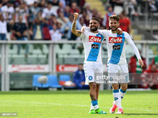 Napoli's Belgian striker Dries Mertens is congratulated by Napoli's Italian striker Lorenzo Insigne after scoring during the Italian Serie A football...