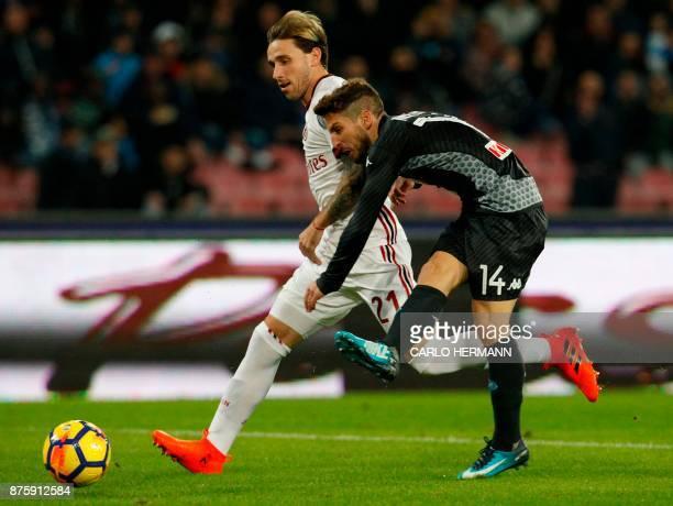 Napoli's Belgian striker Dries Mertens kicks the ball next to Milan's Argentinian midfielder Lucas Biglia during the Italian Serie A football match...