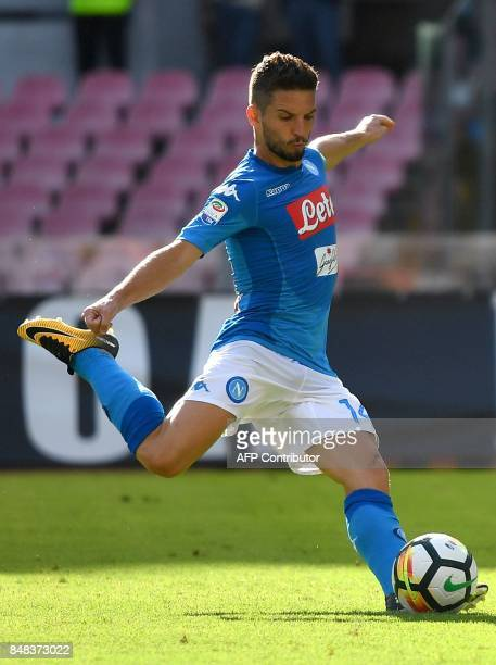 Napoli's Belgian striker Dries Mertens scores a penalty kick during the Italian Serie A football match Napoli vs Benevento on September 17 2017 at...