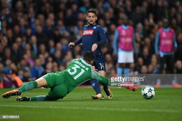 Napoli's Belgian striker Dries Mertens shoots but fails to score past Manchester City's Brazilian goalkeeper Ederson during the UEFA Champions League...