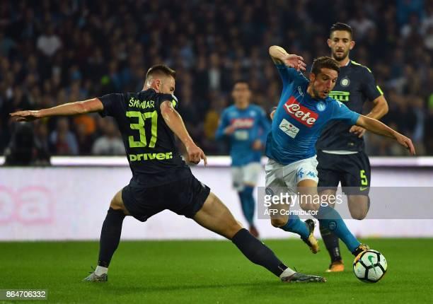 Napoli's Belgian striker Dries Mertens vies with Inter Milan's Slovakian defender Milan Skriniar and Inter Milan's midfielder Roberto Gagliardini...