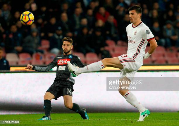 Napoli's Belgian striker Dries Mertens vies with Milan's Italian defender Alessio Romagnoli during the Italian Serie A football match SSC Napoli vs...