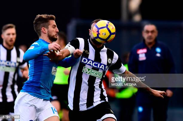 Napoli's Belgian striker Dries Mertens vies with Udinese's Brazilian defender Danilo Larangeira during the Italian Serie A football match Udinese vs...