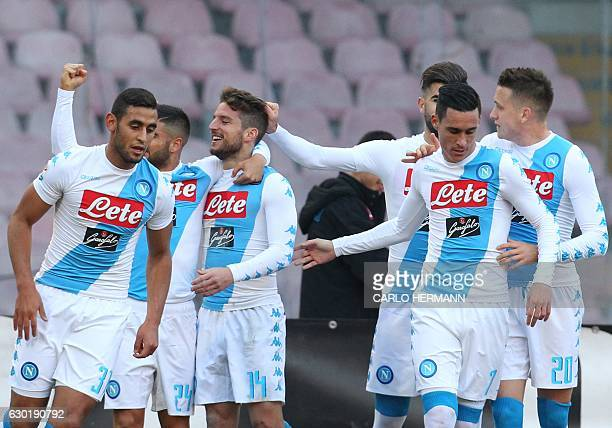 Napoli's Belgium forward Dries Mertens celebrates with team mates after scoring a goal during an Italian Serie A football match between SSC Napoli...