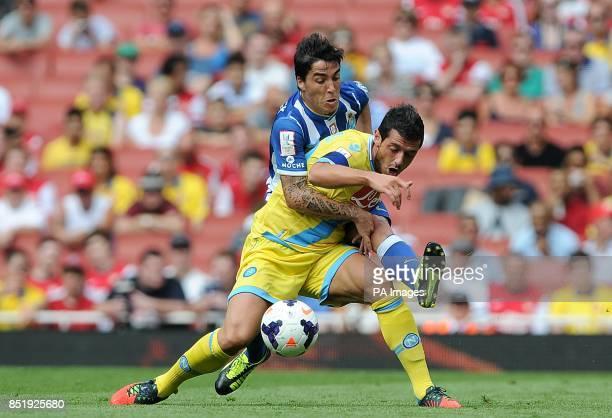 Napoli's Blerim Dzemaili and FC Porto's Josue battle for the ball