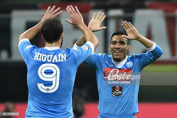 Napoli's Brazilian midfielder Allan celebrates with his teammate Napoli's Argentinian forward Gonzalo Higuain after scoring during the Italian Serie...
