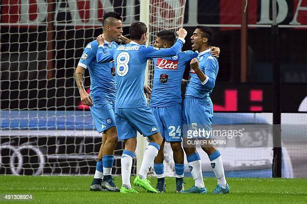 Napoli's Brazilian midfielder Allan celebrates with his teammates after scoring during the Italian Serie A football match between AC Milan and Napoli...