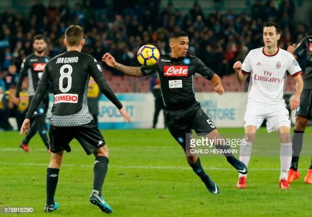 Napoli's Brazilian midfielder Allan controls the ball next to Milan's Croatian striker Nikola kalinic during the Italian Serie A football match SSC...