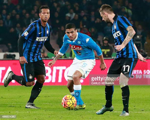 Napoli's Brazilian midfielder Allan fights for the ball with Inter Milan's Croatian midfielder Marcelo Brozovic and Inter's Colombian midfielder...