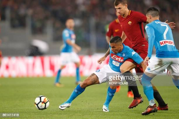 OLIMPICO ROME LAZIO ITALY Napoli's Brazilian midfielder Allan fights for the ball with Roma's Bosnian striker Edin Dzeko during the Italian Serie A...