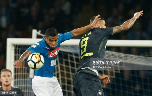 Napoli's Brazilian midfielder Allan heads the ball next to Inter Milan's Argentinian striker Mauro Icardi during the Italian Serie A football match...