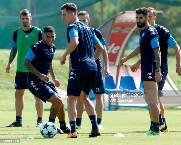 Napoli's Brazilian midfielder Allan Napoli's Polish forward Arkadiusz Milik and Napoli's Albanian defender Elseid Hysaj take part in a training...