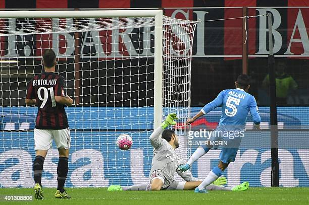 Napoli's Brazilian midfielder Allan shoots to score past AC Milan's Spanish goalkeeper Diego Lopez during the Italian Serie A football match between...