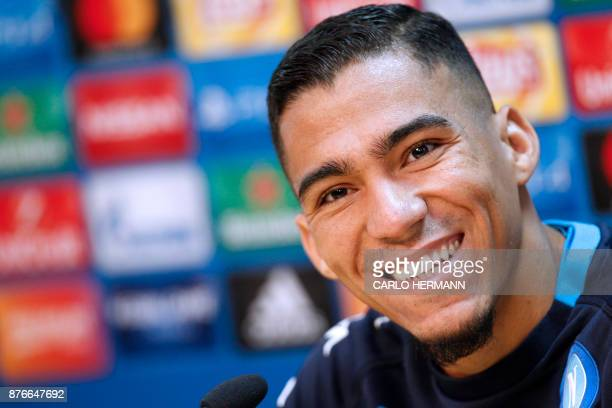 Napoli's Brazilian midfielder Allan smiles during a press conference on the eve of the UEFA Champions League Group F football match SSC Napoli vs FC...
