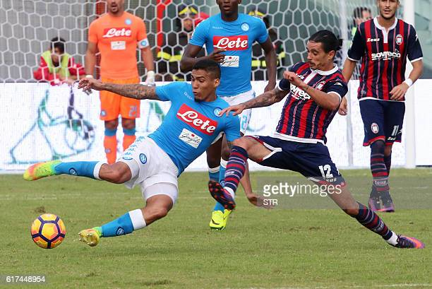 Napoli's Brazilian midfielder Allan vies with Crotone's Adrian Stoian during the Italian Serie A football match between FC Crotone and SSC Napoli at...