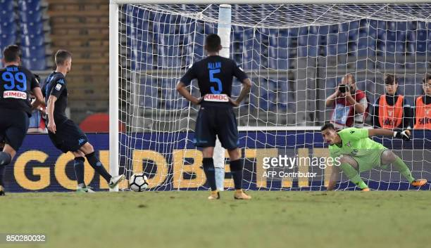Napoli's Brazilian midfielder Jorge Luiz Jorginho kicks to score a penalty during the Italian Serie A football match between Lazio and Napoli at...
