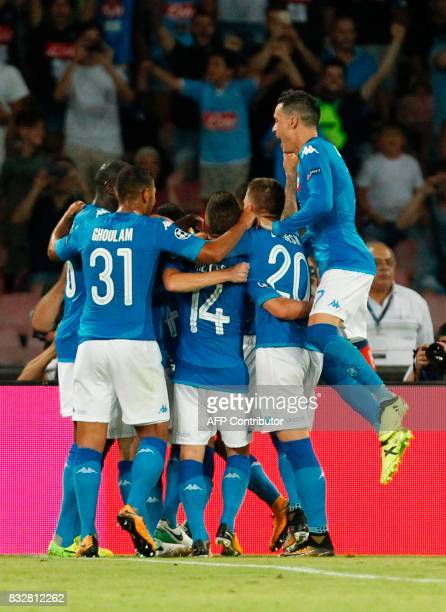 Napoli's Brazilianborn midfielder Jorginho celebrates with teammates after scoring a penalty during the UEFA Champions League Play Off first leg...