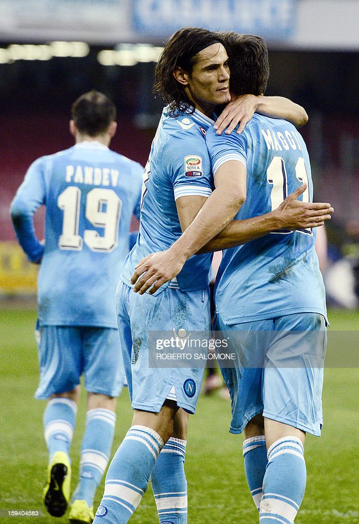 Napoli's Christian Maggio (R) celebrates with team mate Edinson Cavani after scoring a goal during an Italian Serie A football match SSC Napoli vs US Palermo at San Paolo Stadium in Naples on January 13, 2013.