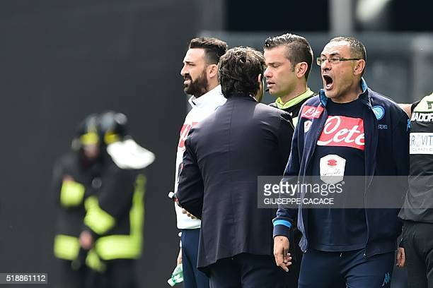 Napoli's coach from Italy Maurizio Sarri reacts during the Italian Serie A football match Udinese vs Napoli at Friuli Stadium in Udine on April 3...