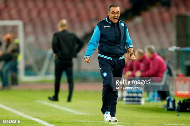 Napoli's coach from Italy Maurizio Sarri reacts during the UEFA Champions League football match Napoli vs Manchester City on November 1 2017 at the...