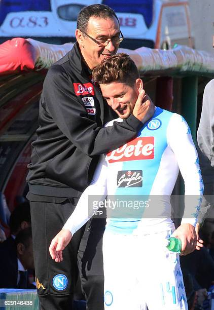 Napoli's coach from Italy Maurizo Sarri hugs Napoli's forward from Belgium Dries Mertens after he scored a goal during the Italian Serie A football...
