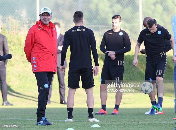 Napoli's coach from Italy Maurizo Sarri looks on during a training session on the eve of the UEFA Champions League football match SSC Napoli vs FK...
