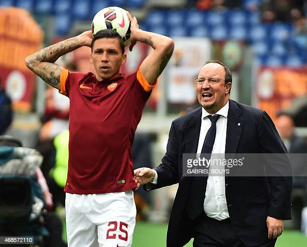 Napoli's coach from Spain Rafael Benitez reacts in front of Roma's defender from Greece Jose Holebas during the Italian Serie A football match...