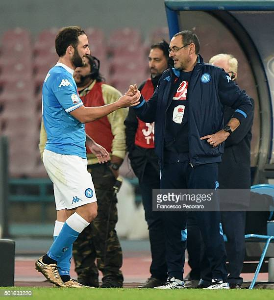 Napoli's coach Maurizio Sarri greets coach player Gonzalo Higuain during the TIM Cup match between SSC Napoli and Hellas Verona FC at Stadio San...