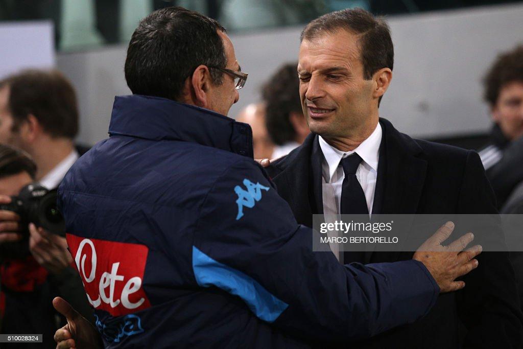 Napoli's coach Maurizio Sarri (L) hugs Juventus' coach Massimiliano Allegri during the Italian Serie A football match Juventus vs Napoli at Juventus Stadium in Turin on February 13, 2016. / AFP / MARCO BERTORELLO