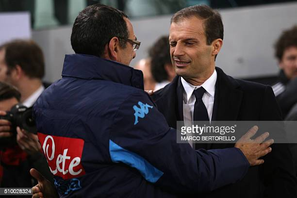 Napoli's coach Maurizio Sarri hugs Juventus' coach Massimiliano Allegri during the Italian Serie A football match Juventus vs Napoli at Juventus...