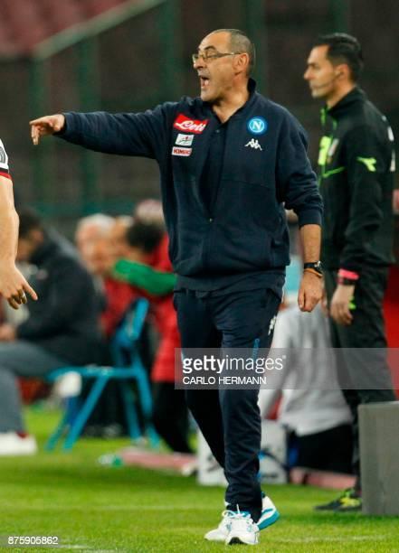 Napoli's coach Maurizo Sarri gestures during the Italian Serie A football match SSC Napoli vs AC Milan on November 18 2017 at the San Paolo Stadium...